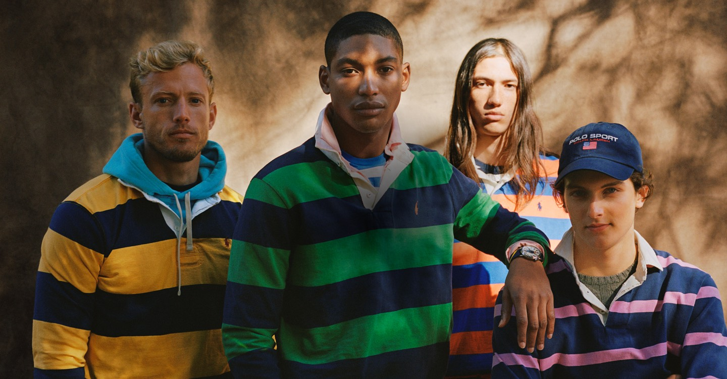 Men in rugbys in different colors, layered over tees & hoodies