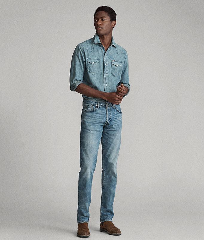 Man in chambray shirt & medium-wash straight jeans