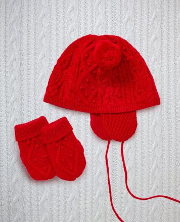 Red Aran-knit hats and mittens.