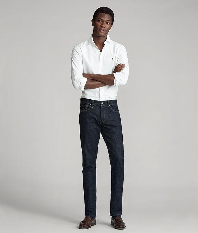 Man in white button-down & dark-wash slim Polo jeans