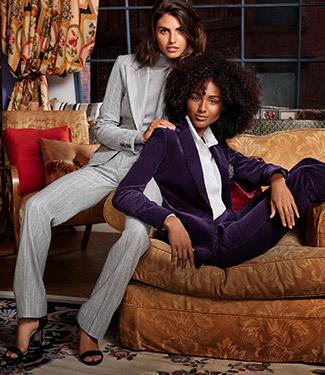 Woman wear suits in grey pinstripe and purple velvet.