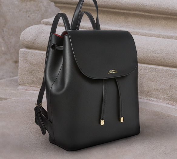 Black leather backpack with front flap drawstring closure