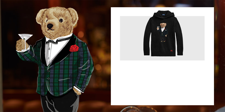 Drawing of the Polo Bear wearing plaid tuxedo jacket holding martini. Black hoodie with Martini Bear at the front.
