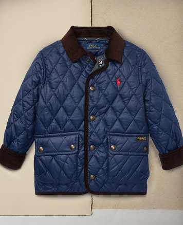 Navy quilted car coat with red pony at the chest.