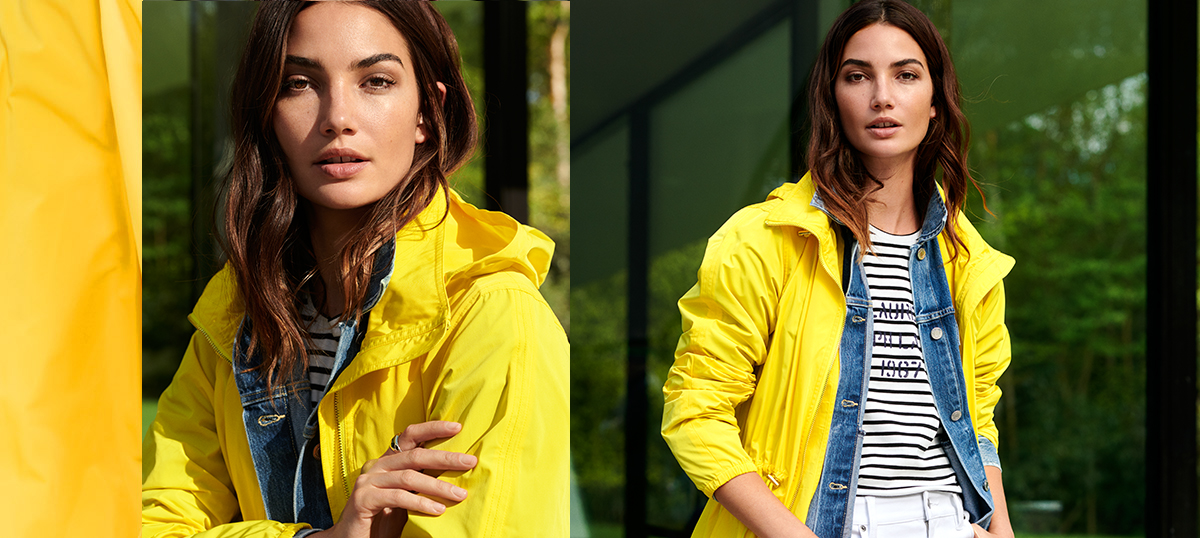 Woman in yellow hooded jacket with elasticized cuffs