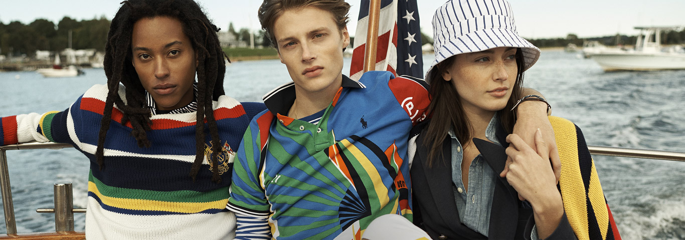 Models on sailboat in nautical-inspired knits & accessories