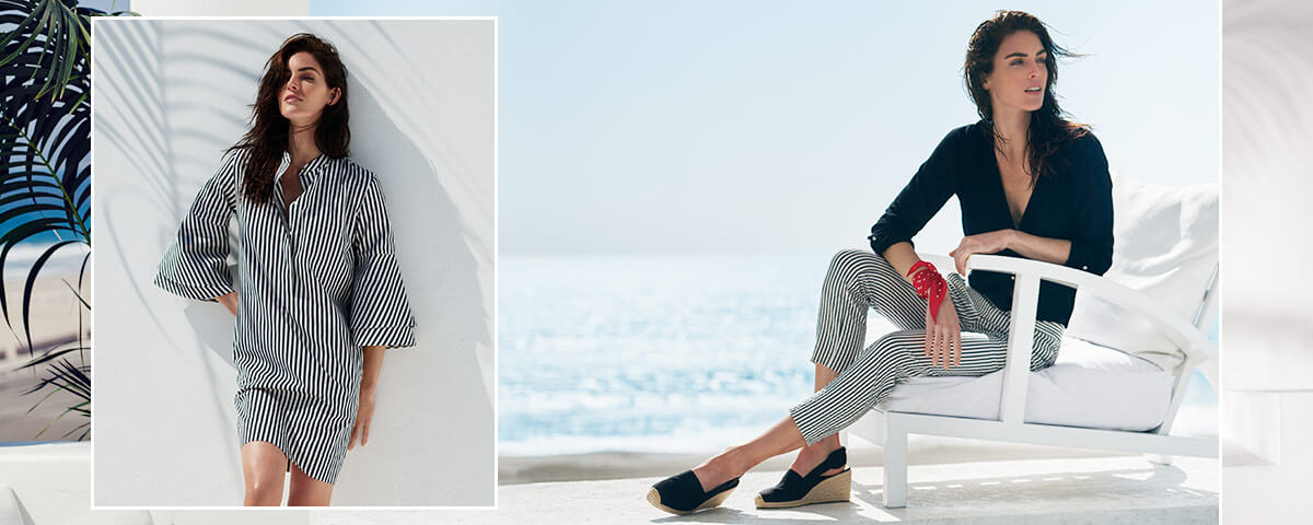 Model Hilary Rhoda in striped shirtdress & striped blazer