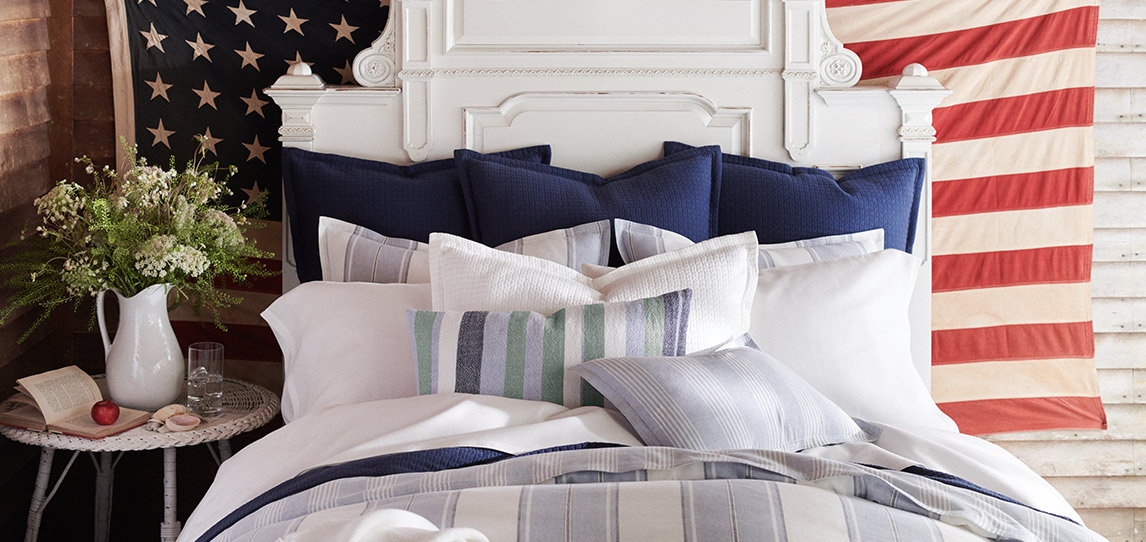 Bed with red, white & blue sheeting