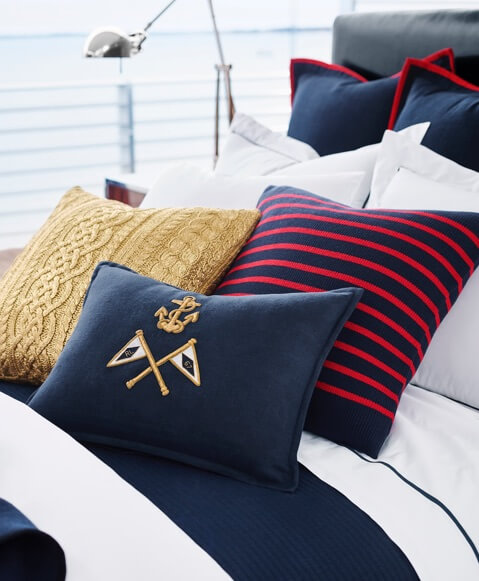 Nautical-inspired navy, striped & gold pillows