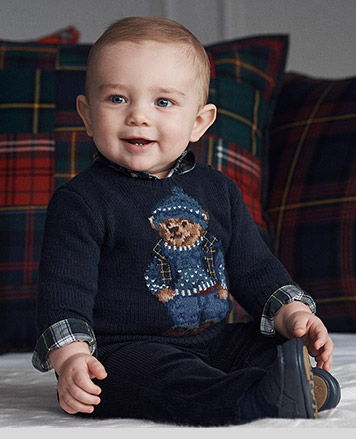 Baby boy wears Polo Bear sweater.