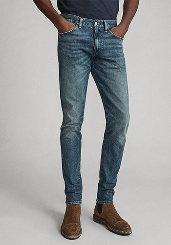 Photograph of man from waist down wearing Polo skinny jeans